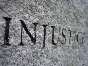 http://www.eliluminador.com/wp-content/uploads/2011/02/injustice.jpg