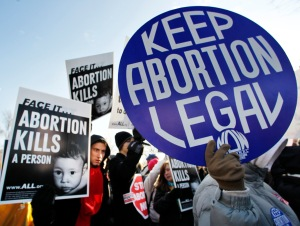 Anti-abortion and abortion activists stand side by side in front of the U.S. Supreme Court, in Washington, Monday, Jan. 24, 2011, during a rally against Roe v. Wade on the anniversary of the U.S. Supreme Court decision.  (AP Photo/Manuel Balce Ceneta)